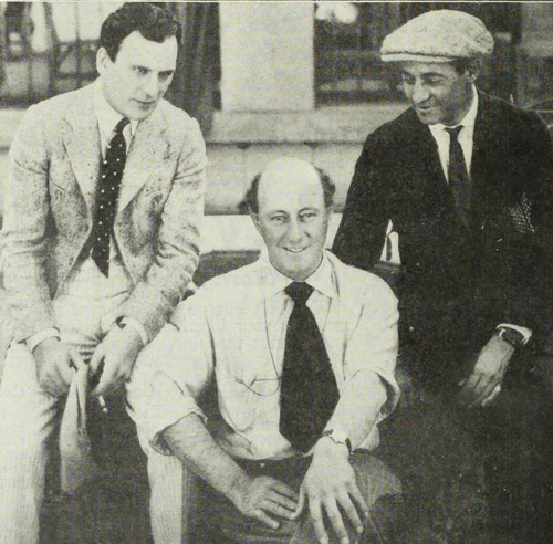 Dexter's return to work after his illness. DeMille is at center and Thomas Meighan. who replaced Dexter in Male and Female, is to the left.