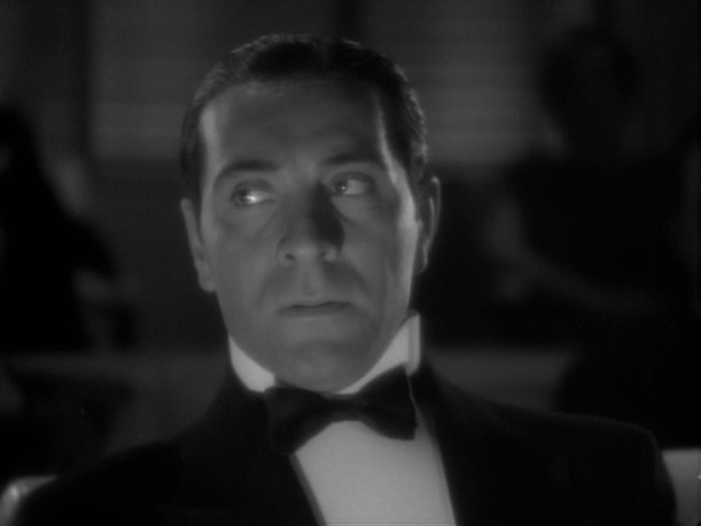 Ricardo Cortez conspires to re-kill Boris Karloff.