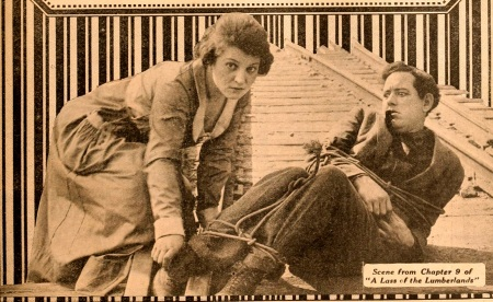 "Helen Holmes lends a hand in ""Lass of the Lumberlands"""