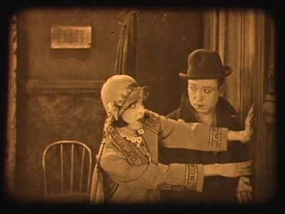 Colleen gets a little help from Harry Langdon.