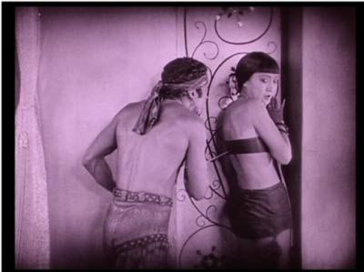 The Thief threatens royal handmaiden (and Mongol spy) Anna May Wong.