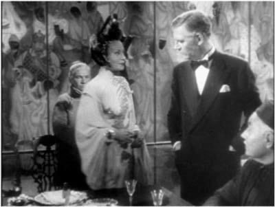 Mother Gin Sling confronts her old enemy (Walter Huston)