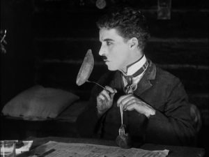 Chaplin's famous dinner roll dance, which he dreams of using to impress Georgia.
