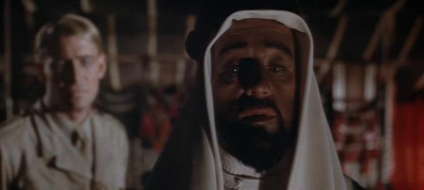 Alec Guinness as the smart, pragmatic Faisal.