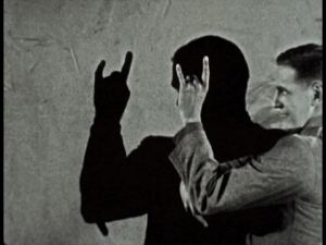 Either he's a very bad shadow puppeteer or he is reminiscing about that bodacious Black Sabbath concert.