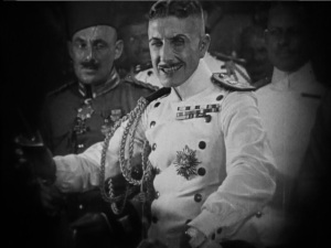 """Roy D'Arcy as von Stroheim's surrogate. """"Pardon me, would you mind dancing with a mild mannered pervert?"""""""