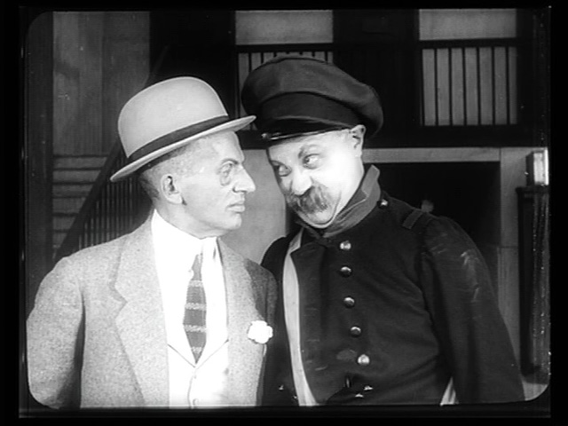 Emil Jannings (right, with the mustache) sizes up his new prisoner.