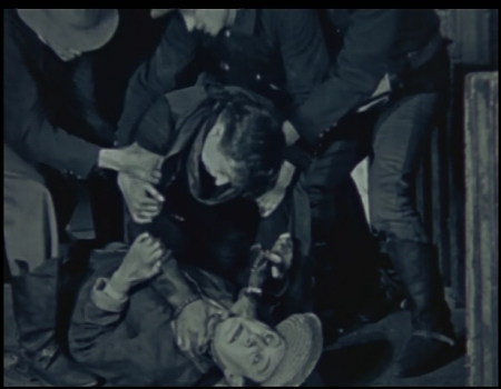 Deering attempts to remove Jordan's head.