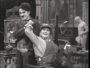 Chaplin and Purviance breaking character.