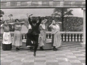 Chaplin leads the dance of the cleaning ladies.