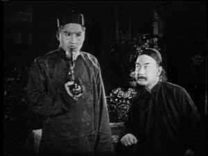 Poor Fujita is not impressed with his co-star's phony Chinese-isms.